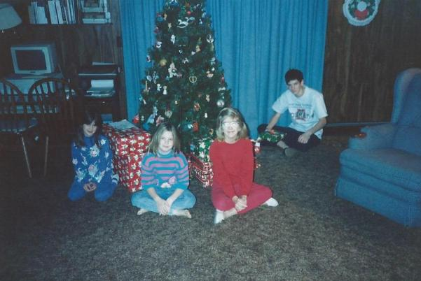 My parents made us take this exact picture every year at Christmas.