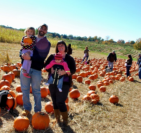 This picture was taken last year. It was our first pumpkin picking trip with both of our girls!