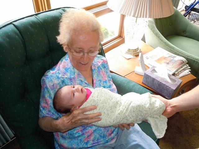 Grams meeting her great-granddaughter for the first time.