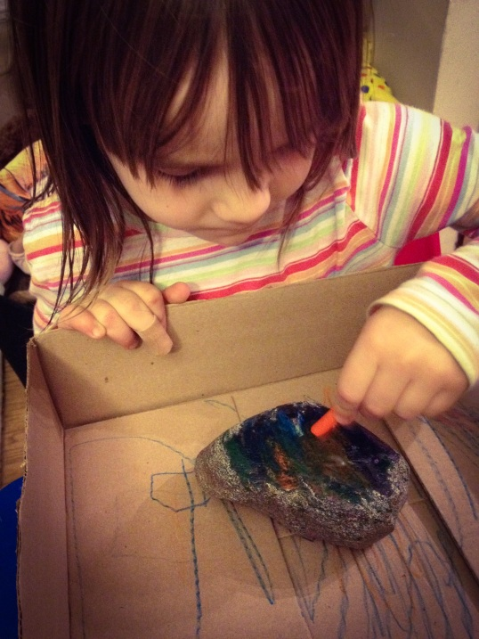 4-year-old Caroline wanted to cover every inch of that big rock with crayon!